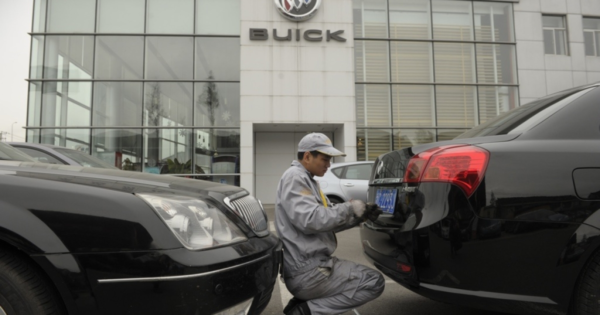 A mechanic works on a Buick at a General Motors (GM) dealership in Shanghai on Dec. 6, 2011.</p>