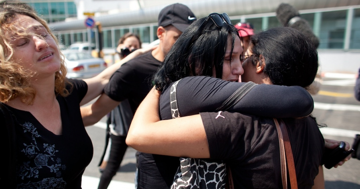The sisters of a woman who was killed during an attack in Bulgaria mourn as they wait for their wounded relatives at the Ben Gurion International Airport on July 19, 2012 near Tel Aviv, Israel.</p>