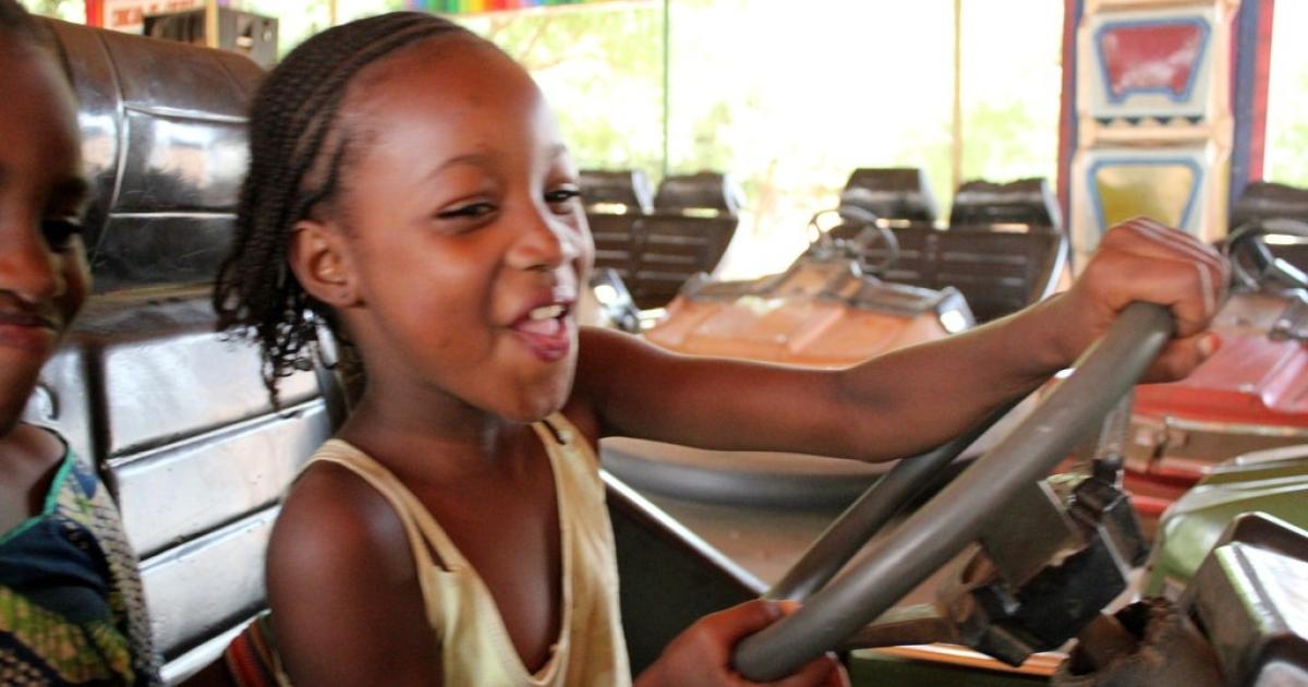 A little girl has a blast on the bumper cars at Manuel Marco's Parko de Corinhog do Choque in Guinea-Bissau.</p>