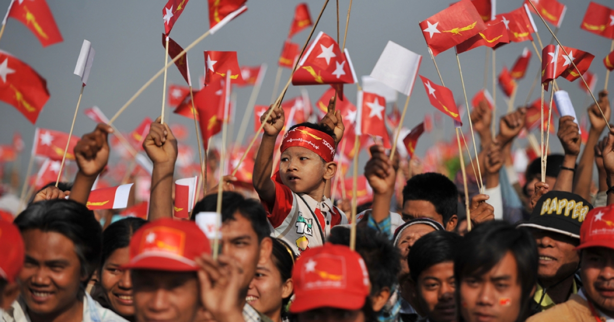 Supporters wave National League for Democracy (NLD) flags at an electoral campaign rally in Naypyidaw on March 6, 2012.</p>