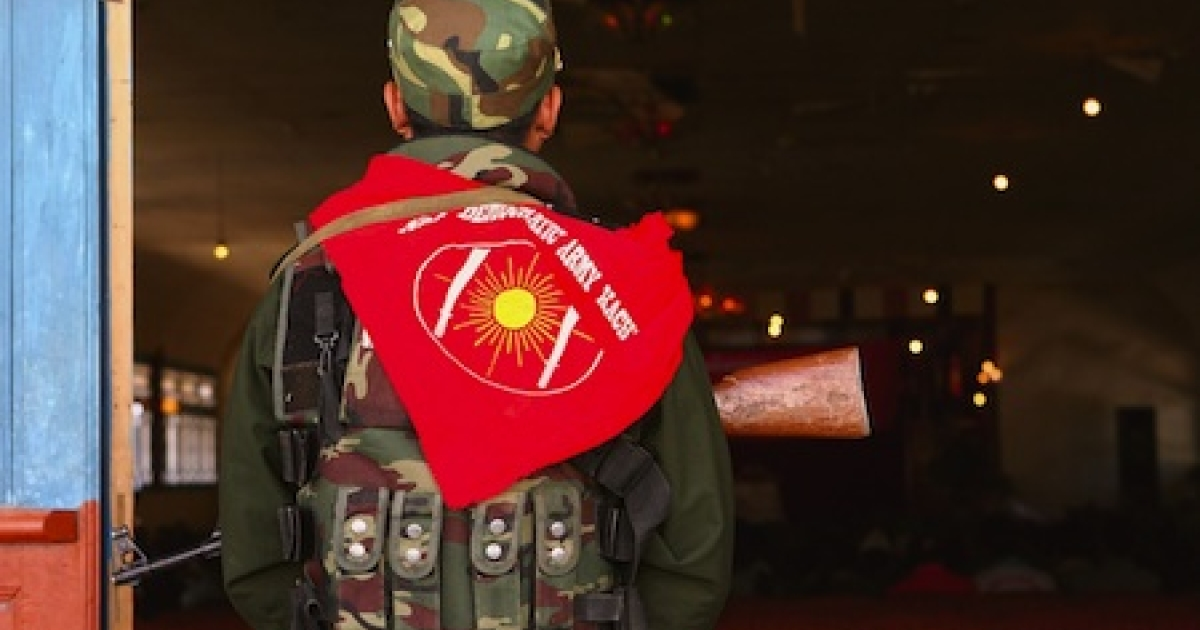 PANWA, MYANMAR: An ethnic Kachin militia soldier on guard in Kachin State, Burma, officially known as Myanmar</p>