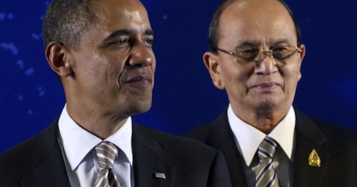 U.S. President Barack Obama stands by Myanmar President Thein Sein at an Association of Southeast Asian Nations summit.</p>