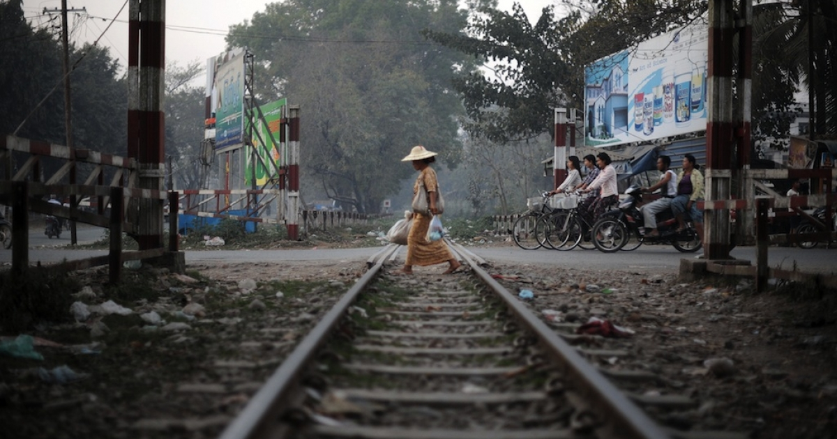 A Myanmar woman crossing railway tracks in Myitkyina, northern Kachin state. Human Rights Watch reported the Burmese military is guilty of abuses against civilians in the region.</p>