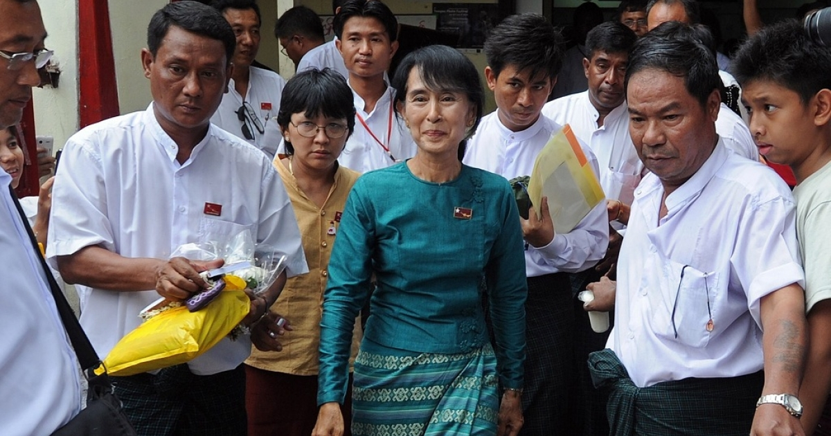 The leader of Burma's National League for Democracy Aung San Suu Kyi walks out of her party headquarters on Apr. 7, 2012.</p>