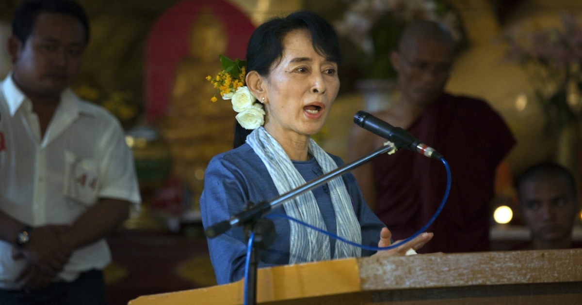 Democracy leader Aung San Suu Kyi speaks during 20th anniversary ceremonies to honor her winning the Nobel Peace prize December 10, 2011 in Yangon, Myanmar. The pace of change in Myanmar brought U.S Secretary of State Hillary Clinton to the country where she discussed further paths to reform and crucial talks with both Aung San Suu Kyi and the highest levels of the Burmese government.</p>