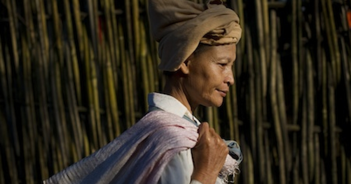 This picture taken on November 4, 2010 shows a Myanmar woman walking inside the Mae La refugee camp on the Thai-Myanmar border. Myanmar, also known as Burma, voted on November 7, 2010 in its first election in 20 years with complaints of intimidation adding to fears the poll is a sham to create a facade of democracy after decades of iron-fisted military rule.</p>