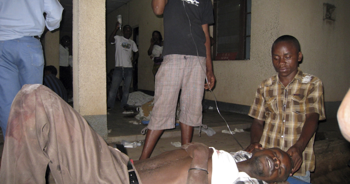 A victim of armed raiders, who killed at least 36 people on September 18 when they stormed a Burundi bar and opened fire on patrons, is tended to at the Prince Regent Charles Hospital in Bujumbura on September 19, 2011. The attackers raided a bar in Gatumba area, some eight miles west of the capital Bujumbura, which lies in a stronghold of the former National Liberation Forces rebels whose leader Agathon Rwasa has been blamed for a recent spate of attacks.</p>