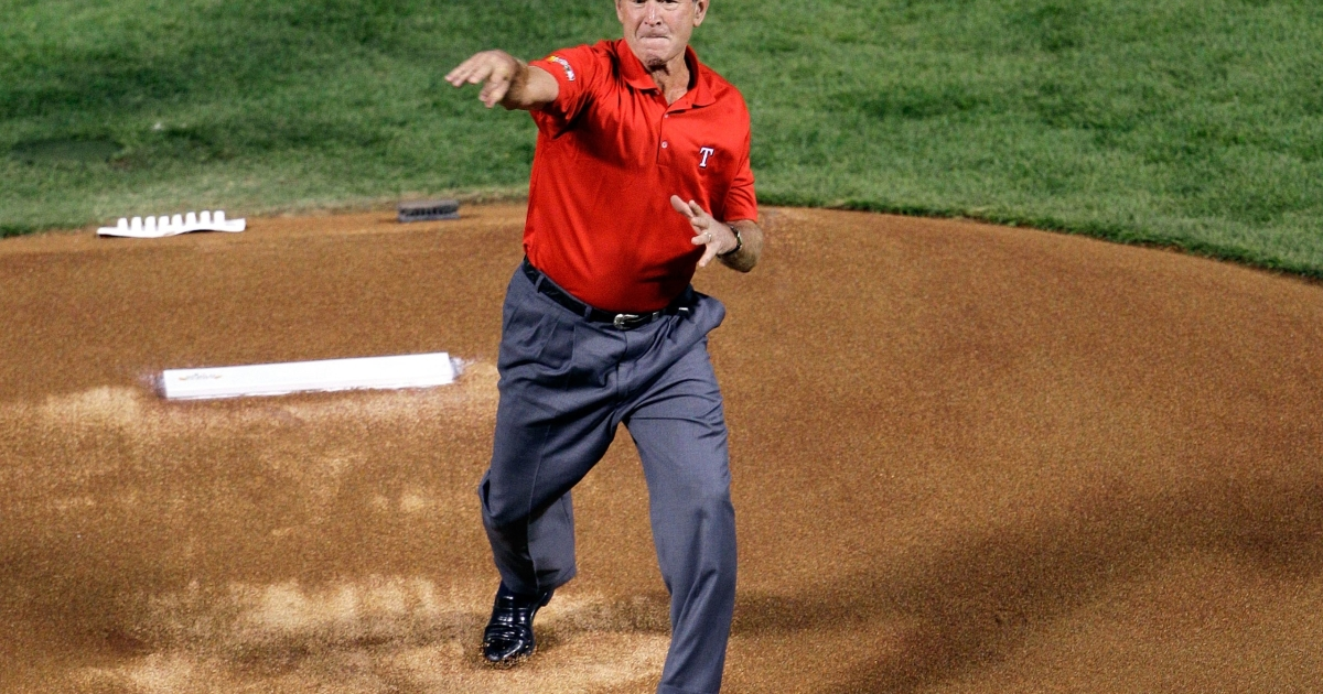 Former president George W. Bush throws out the ceremonial first pitch prior to Game Four of the MLB World Series between the St. Louis Cardinals and the Texas Rangers at Rangers Ballpark in Arlington, Texas, on October 23, 2011.</p>