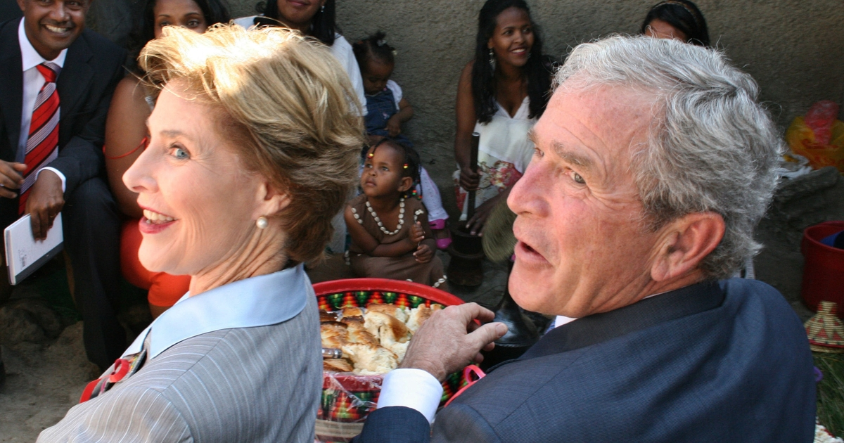 George W Bush and his wife, former first-lady Barbara, visit a US-funded hospital treating people with HIV/AIDS in Addis Ababa on Dec 4 during the final leg of a three-country tour that included stops in Zambia and Tanzania.</p>