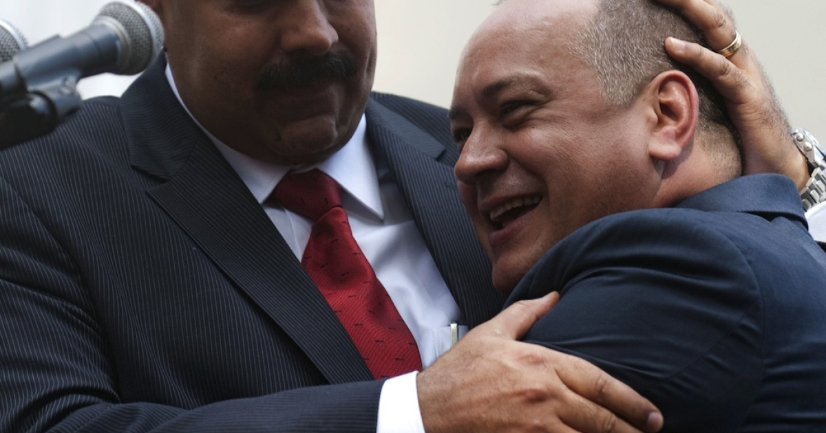 Venezuelan Vice-President Nicolas Maduro (L) embraces the president of the Venezuelan National Assembly, Diosdado Cabello, outside the National Assembly in Caracas on January 5, 2013. Venezuelan lawmakers gathered Saturday for a key leadership vote and debate as President Hugo Chavez's battle with cancer appeared almost certain to delay his swearing-in for a new six year term.</p>