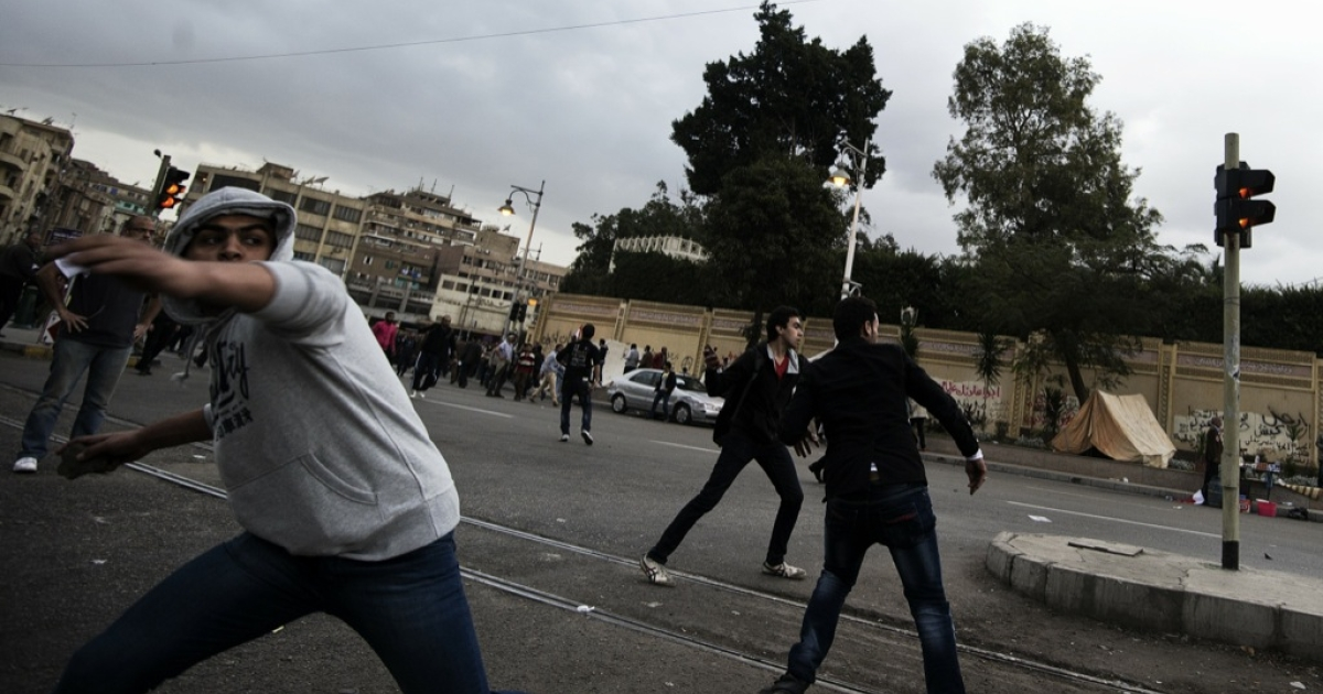 Supporters of Egyptian President Mohammed Morsi clash with anti-Morsi protesters outside the Egyptian presidential palace on Dec. 5, 2012 in Cairo, Egypt. Islamist supporters of Egypt's President Mohamed Morsi chased opposition protesters away from the presidential palace, as the vice president said a vote on a controversial charter would go ahead as planned.</p>
