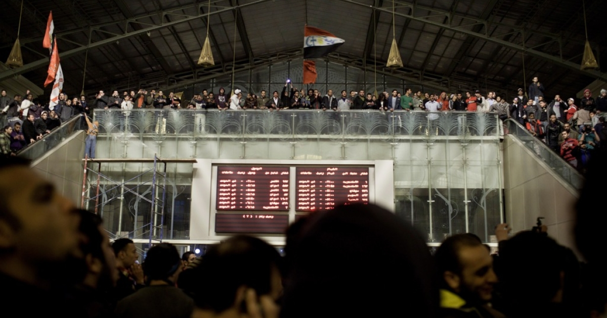 Mourners gather at Cairo's railway station to greet soccer fans returning from Port Said, where a deadly riot broke out after the match between Al Masry and Al Alhy yesterday.</p>