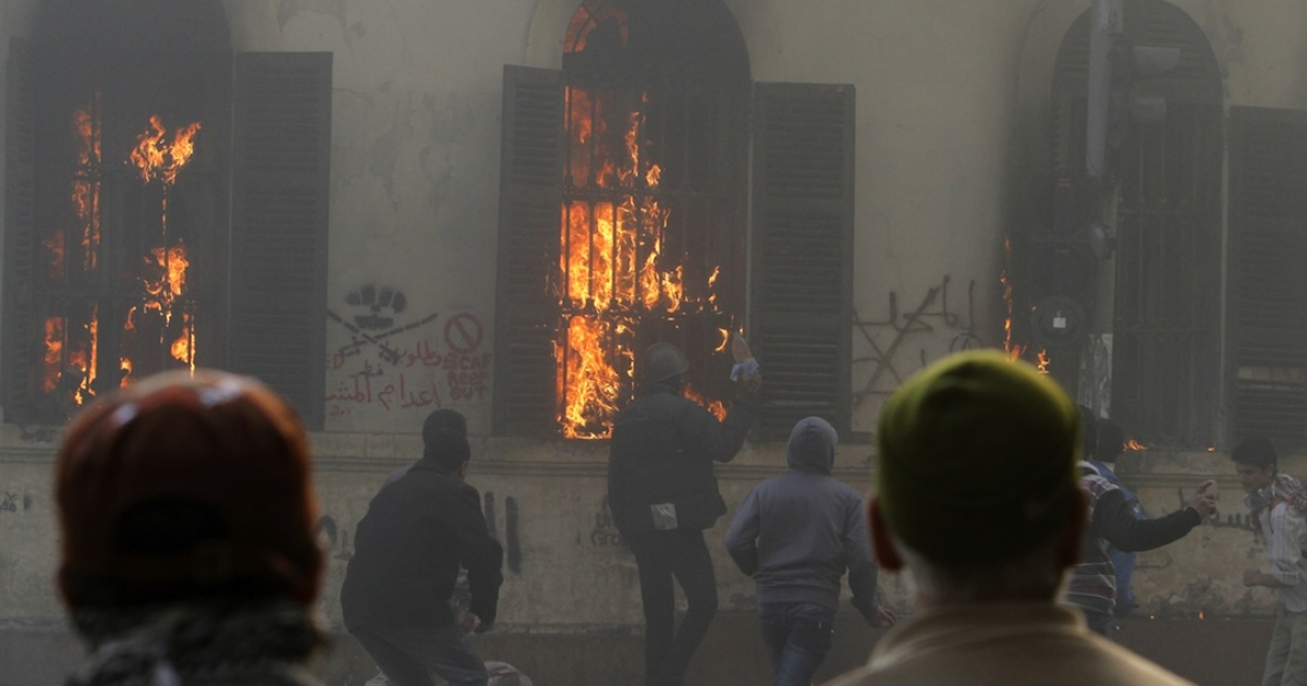 Egyptian protesters set the ground floor of the building housing the ministry of transport and communications in Cairo on fire during protests on December 17, 2011.</p>