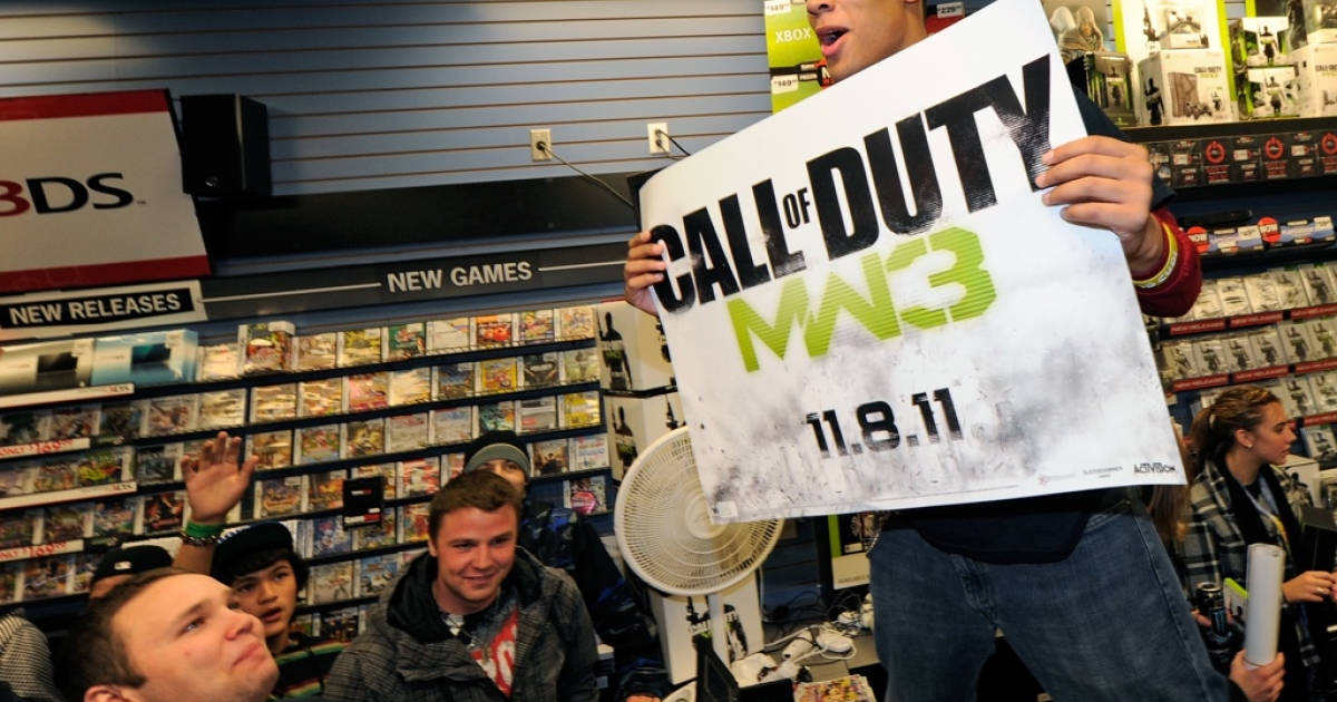A clerk holds a banner during a launch event for the highly anticipated video game,