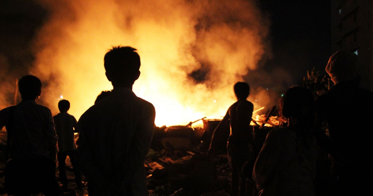 The Cambodian army destroyed a Phnom Penh slum, Borei Keila, earlier this year. That night, villagers light giant infernos that burned into the night.</p>