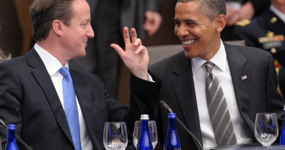 UK Prime Minister David Cameron, left, and President Barack Obama confer at the NATO meeting in Chicago on May 21, 2012.</p>