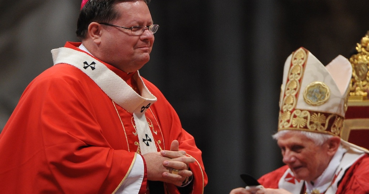 Canada's Archbishop of Quebec Gerard Cyprien Lacroix (L) receives the Pallium from Pope Benedict XVI during the solemn mass at St. Peter's basilica to celebrate the feast of Saint Peter and Saint Paul on June 29, 2011 at The Vatican.</p>