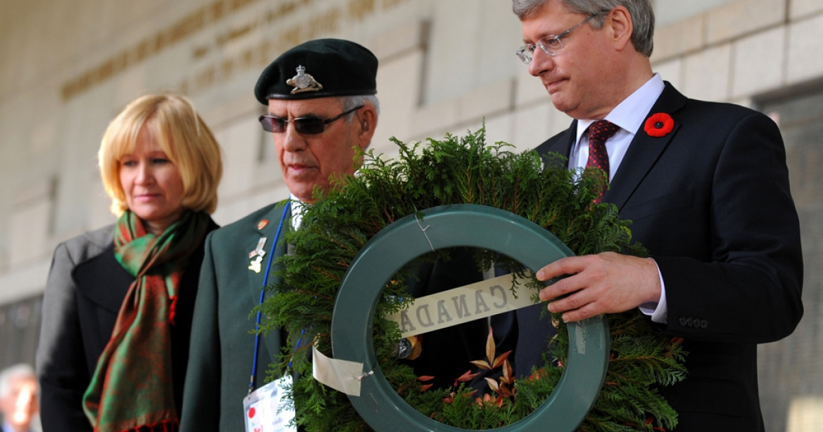 Canada's Prime Minister Stephen Harper lays a wreath during a Remembrance Day ceremony at the War Memorial Gloster Valley, north of Seoul, Nov. 11, 2010.</p>
