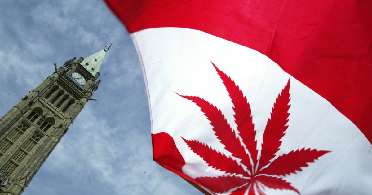 A Canadian flag with a marijuana leaf alongside Parliament Hill in Ottawa, on June 5, 2004.</p>