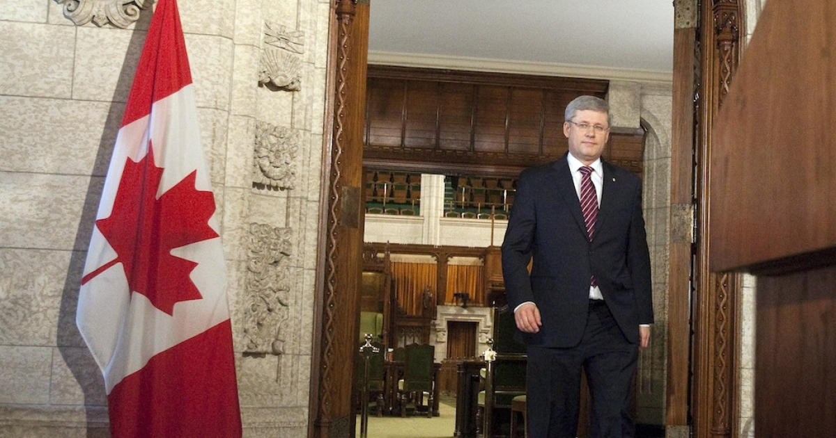 Canadian Prime Minister Stephen Harper arrives for a press conference in the foyer of the House of Commons in Ottawa, Canada, on March 25, 2011.</p>