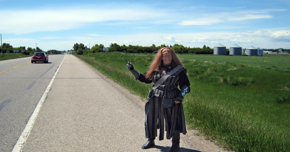 Klingon Debbie Hodgins of Oshawa, Ontario hitches into Vulcan in the middle of Canada's vast western plains. A Klingon is an unexpected sight in Canada's vast western plains, among the lonely oil wells, cow pastures and wheat fields.</p>