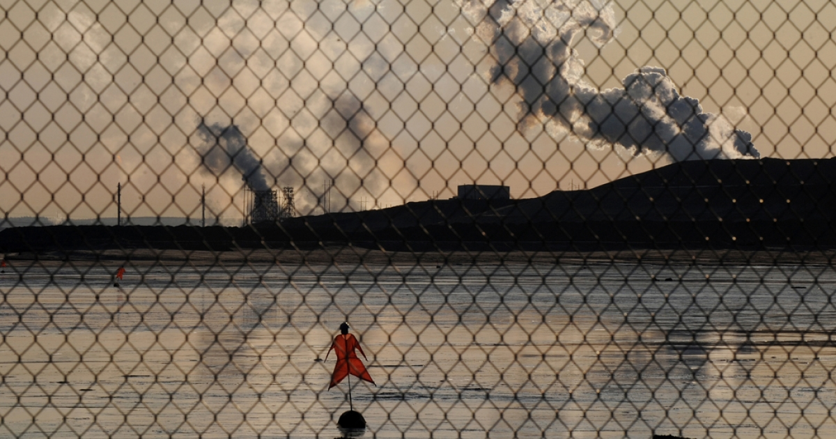 A tailings pond in front of the Suncor oil sands extraction facility near the town of Fort McMurray in Alberta, Canada. Environmentalists have long pushed for an end to Canada's oil sands mining. Now, Alberta has seen three oil spills in two months, fueling fears of contaminated drinking water.</p>