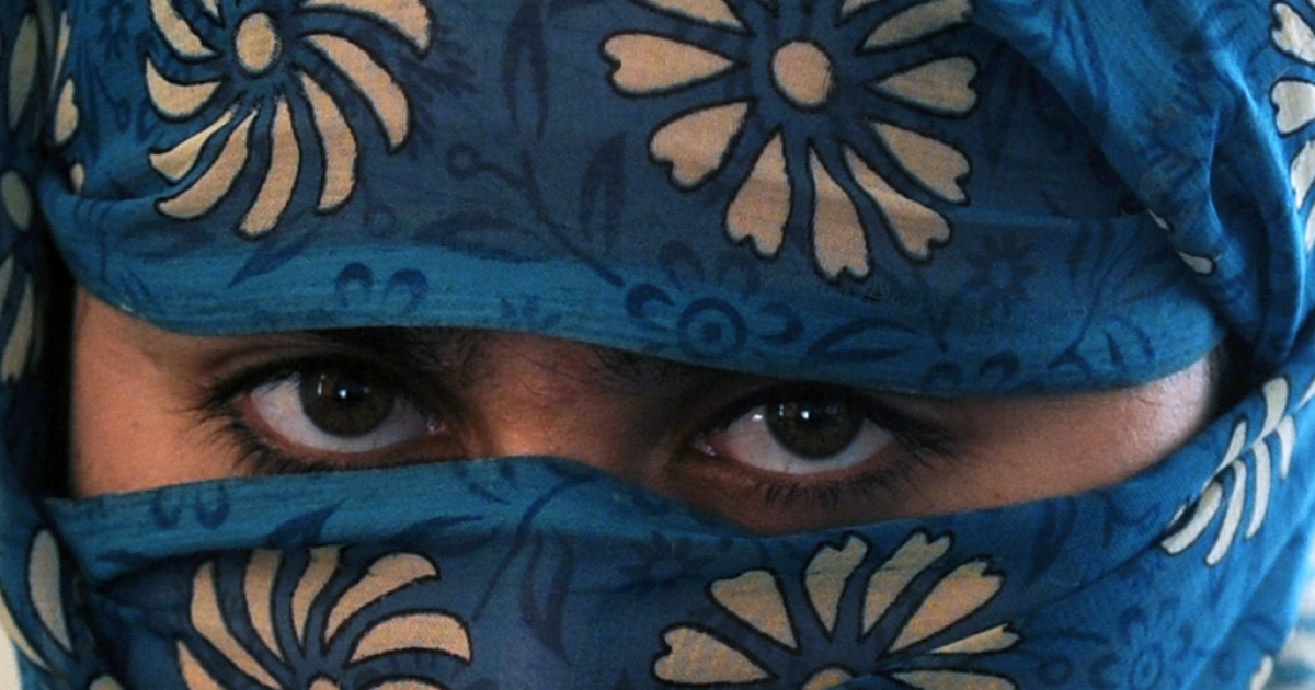 An Afghan woman poses in a secret women's shelter in Kabul, on February 23, 2011.</p>