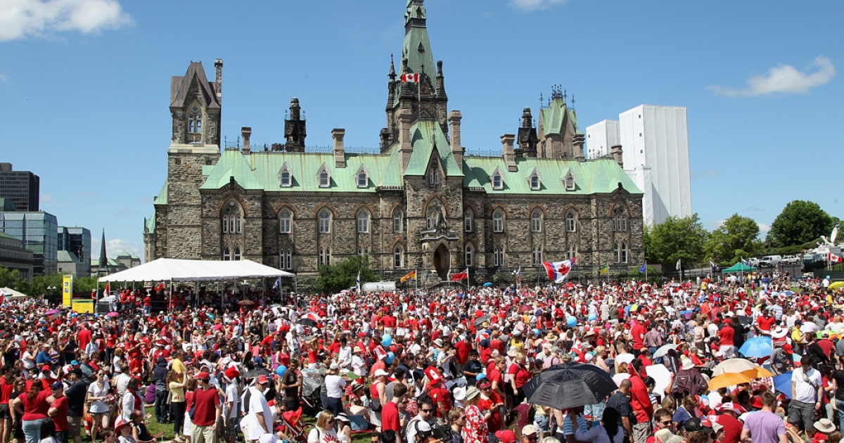 Canadians take part in Canada Day celebrations on July 1, 2011, in Ottawa, Canada.</p>