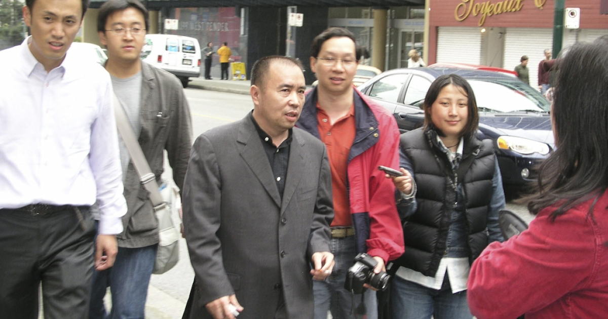 Chinese fugitive Lai Changxing (C) speaks to reporters June 1, 2006, in Vancouver, Canada. Lai, the alleged boss of a multi-billion-dollar smuggling ring, has been fighting to stay in Canada since fleeing China in 1999 and claiming refugee status in 2000. In his appeals to stay in Canada he argued that he will face persecution and certain death if sent home. Lai's 11-year legal battle to stay in Canada ended July 21, 2011 after a court refused to stay his deportation.</p>