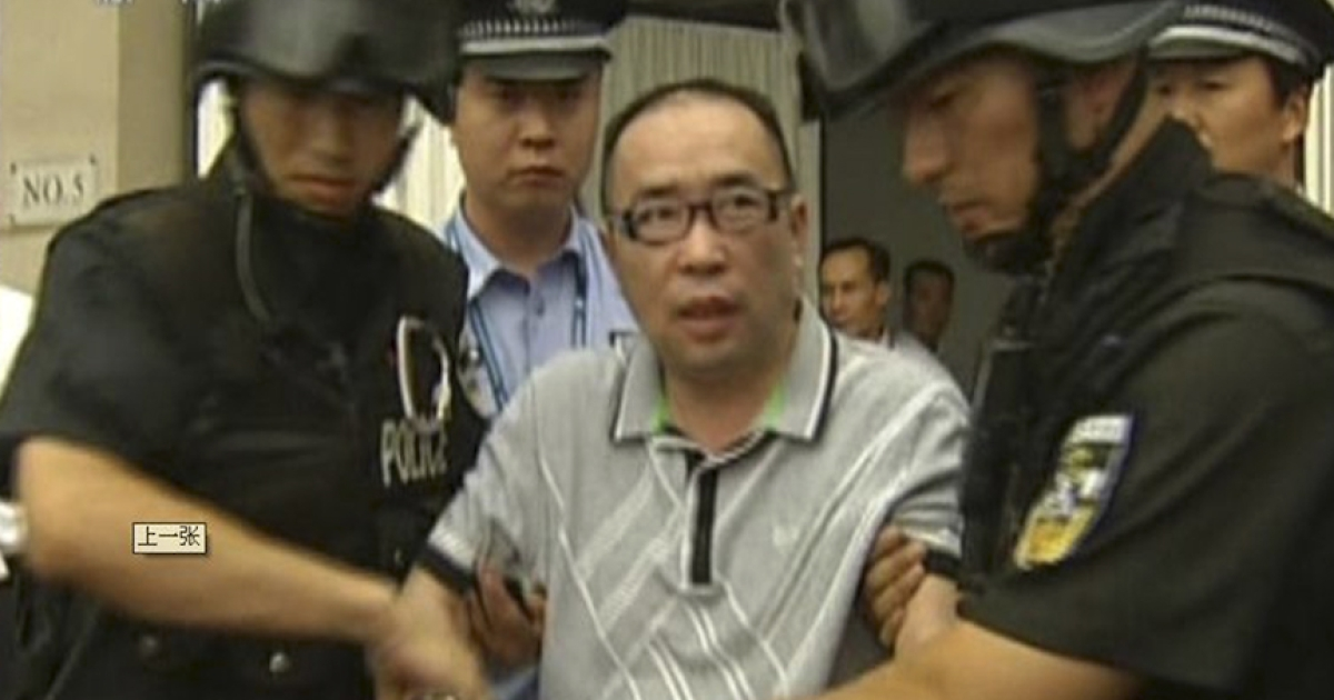 This TV grab taken on July 23, 2011 from China's Central Television shows fugitive Chinese businessman Lai Changxing escorted by Chinese authorities after he landed in the Chinese capital aboard a civilian flight in the custody of Canadian police, in Beijing. Lai Changxing arrived in Beijing on July 23, 2011 after being deported from Canada, ending a 12-year legal and diplomatic tug-of-war that tested the countries' relations.</p>