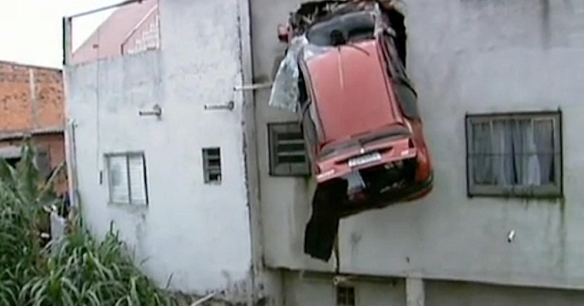 A car flew off a São Paulo, Brazil, road on April 15, 2012, and got stuck in the second-story wall of a house.</p>