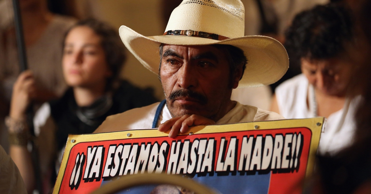 A protester listens during a protest calling for the end of the drug war on September 6, 2012 in the Harlem neighborhood of the Manhattan borough of New York City. Mexicans who have lost loved ones in their country's drug war joined with American supporters as part of  the Caravan for Peace with Justice and traveled some 6,000 miles through 25 cities, including Los Angeles, Houston, Atlanta and Chicago before arriving to New York. They protested the continued war on drugs on both sides of the U.S.- Mexico border, which has left tens of thousands of people dead. The caravan is due to arrive in Washington D.C. for its final stop September 10.</p>