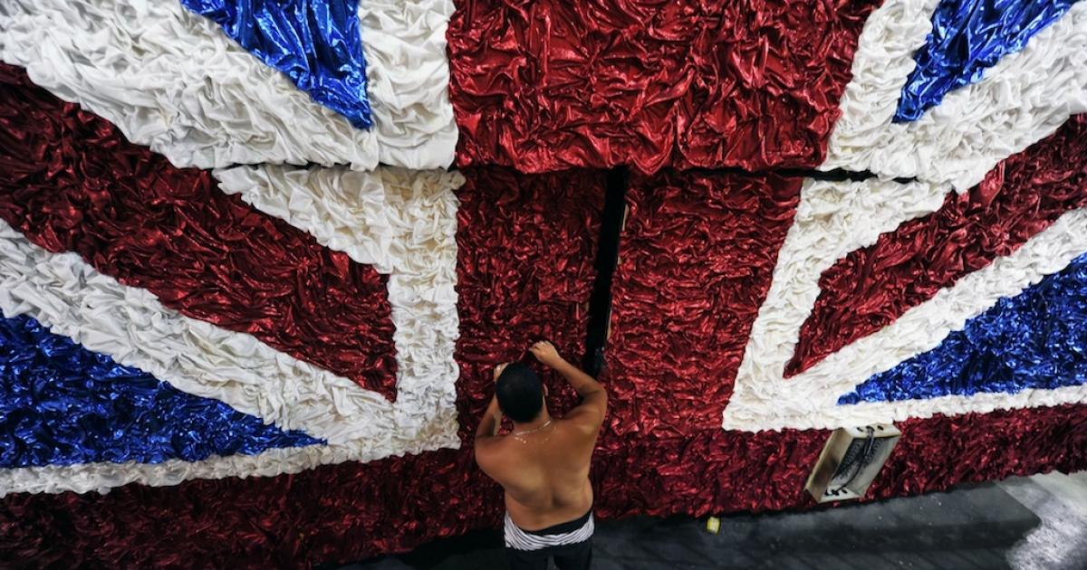 A member of the União da Ilha do Governador samba school works on a float in Samba City, Rio de Janeiro, on February 2, 2012, during preparations for the samba schools parade.</p>