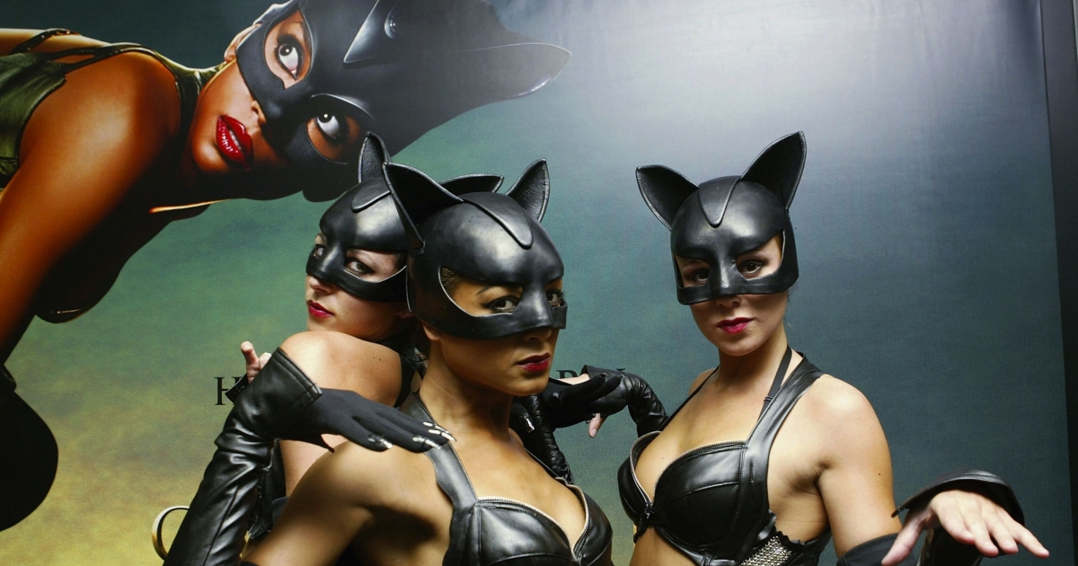 Models dressed as Catwoman arrive at the European Premiere of the Halle Berry film