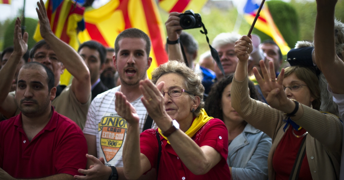 Demonstrators in Barcelona on Thursday celebrate the Catalan regional parliament's vote in favor of a referendum on independence, which is compounding the Spanish crisis.</p>
