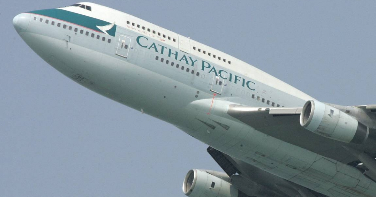 A Cathay Pacific passenger jet takes off from Hong Kong. The airline sacked a pilot and a flight attendant after photographs of them havig oral sex in a cockpit appeared online.</p>