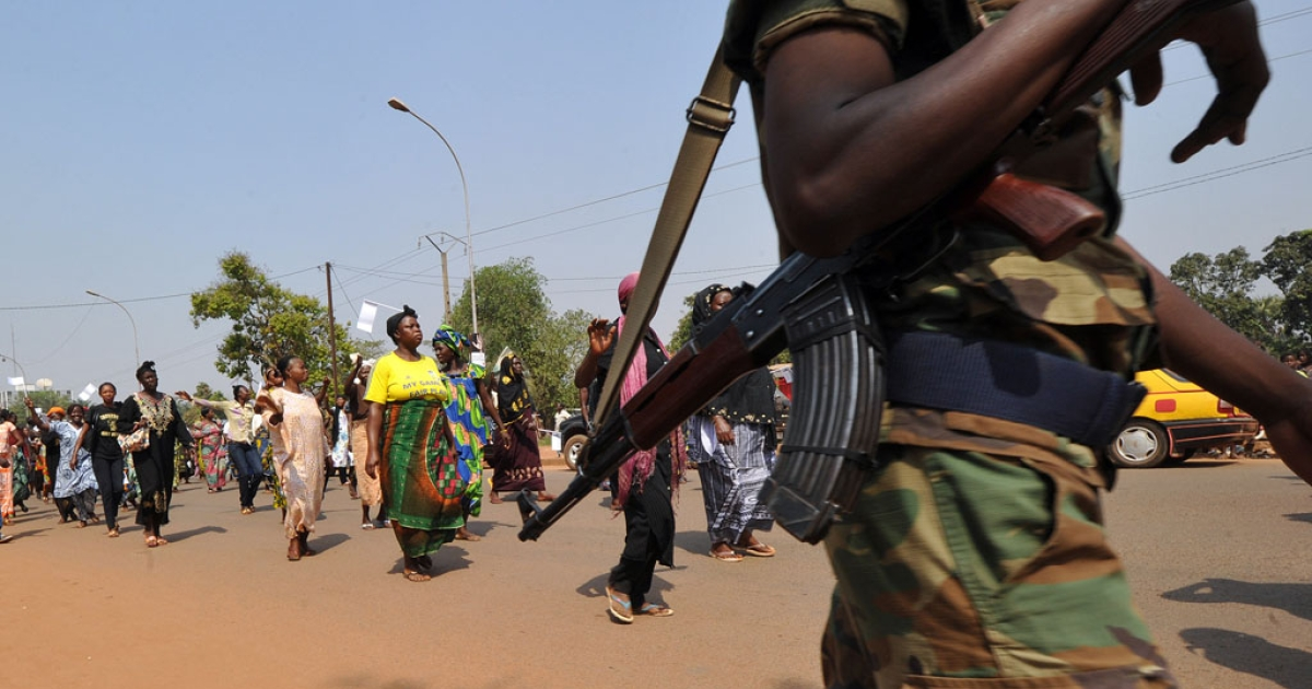 A Central African Republic soldier protects a women's march in Bangui on December 28, 2012. Since then, things have only grown worse.</p>