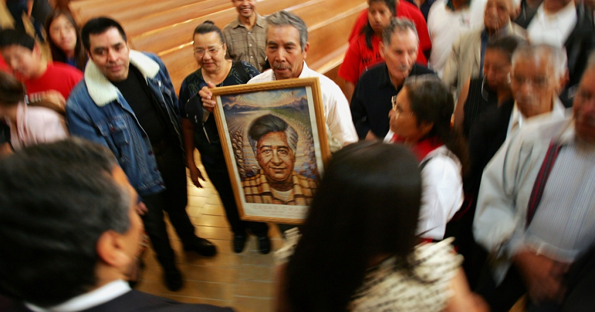 A man holds a portrait of Cesar Chavez the founder of the United Farm Workers of America. The Labor Department named an auditorium after Chavez on March 26, 2012, and Los Angeles is preparing to mark his legacy with volunteerism and holidays.</p>