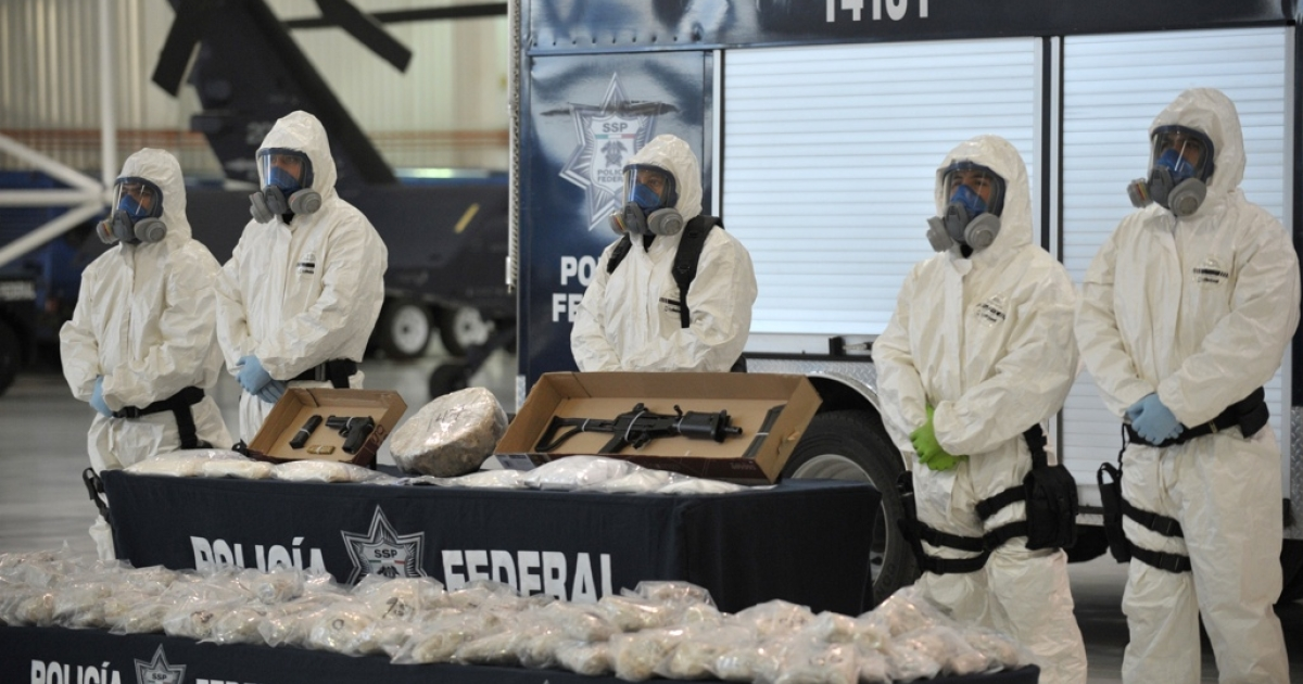 Mexican police on Feb. 14 show the press drugs and weapons seized from alleged members of the Pacific drug cartel run by Joaquin