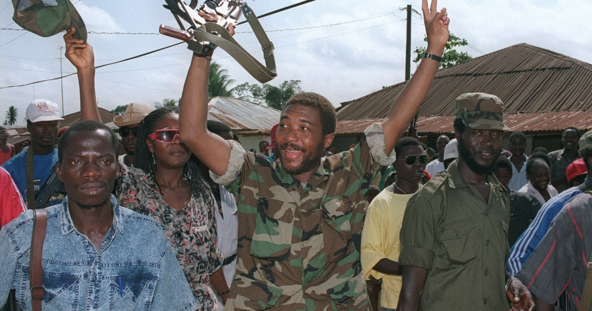 Former Liberian leader, Charles Taylor, celebrating with rebel troops in the height of his power.</p>
