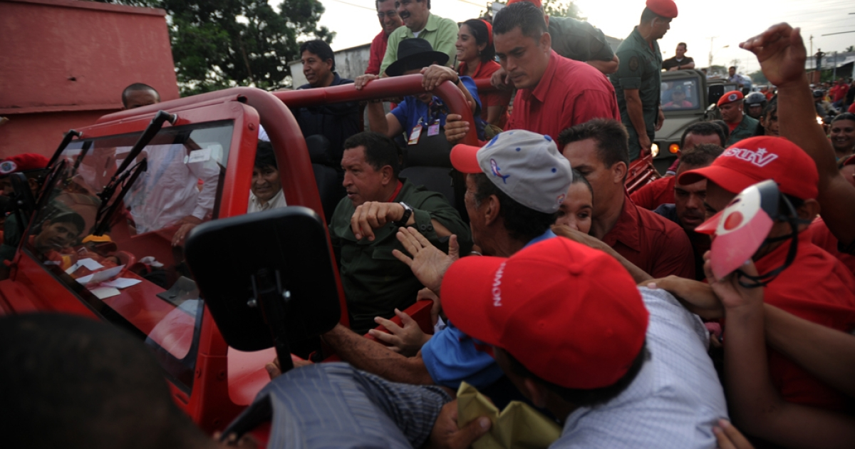 Venezuelan President Hugo Chavez and his Bolivian counterpart Evo Morales are greeted by supporters on their arrival at Sabaneta, where Chavez was born.</p>