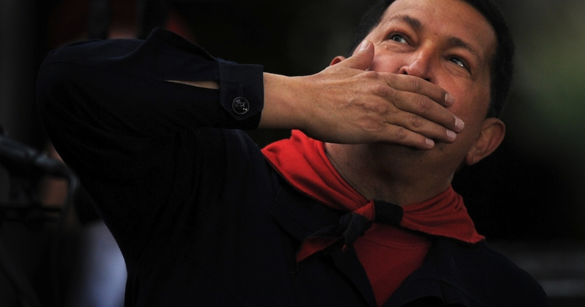 Venezuelan President Hugo Chavez blows kisses to supporters during the commemoration of the ninth anniversary of the failed coup against him, in Caracas on April 13, 2011.</p>