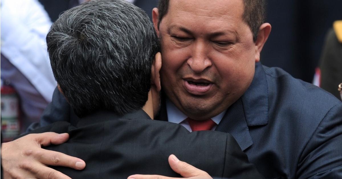 Ahmadinejad hugs his friend.</p>