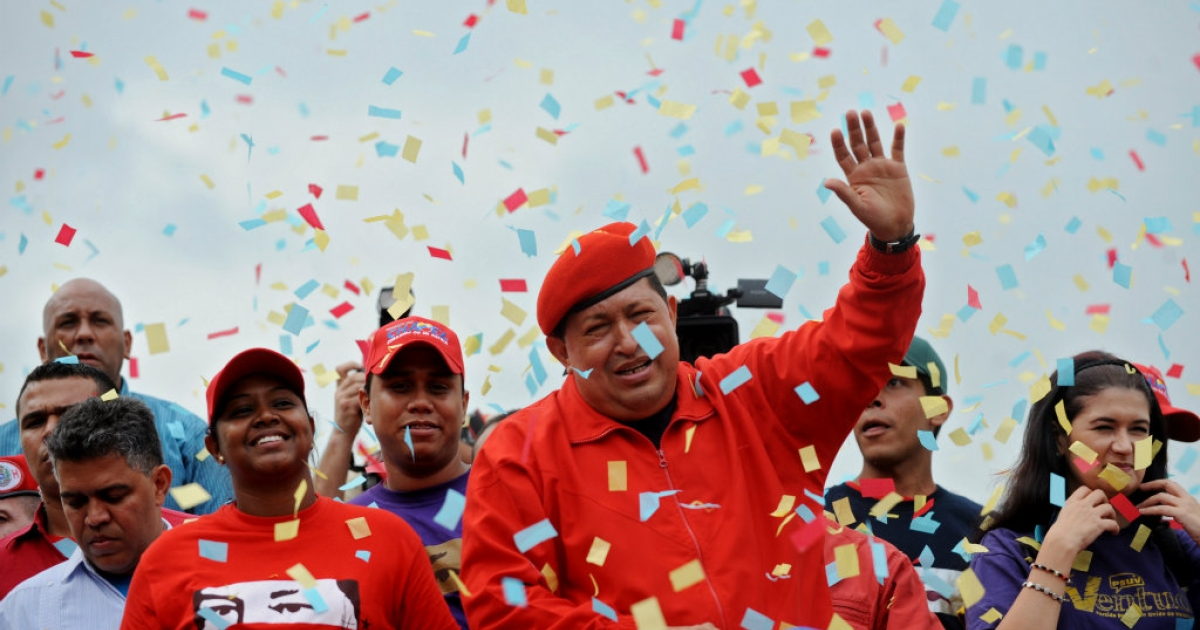 Venezuelan President Hugo Chavez waves to supporters during a campaign rally for his re-election.</p>