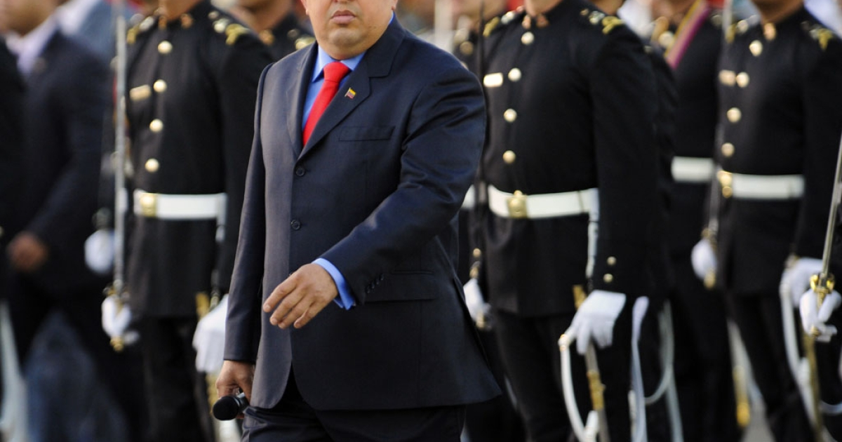 Venezuelan President Hugo Chavez walks during the military inauguration ceremony of his new Defense Minister Gen. Henry Rangel Silva (not in frame) on January 17, 2012 in Caracas. LEO RAMIREZ/AFP/Getty Images</p>