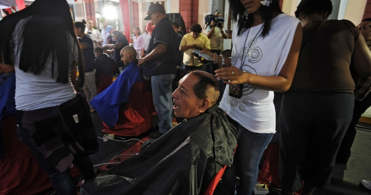 Venezuelans shave their heads in solidarity with Chavez.</p>