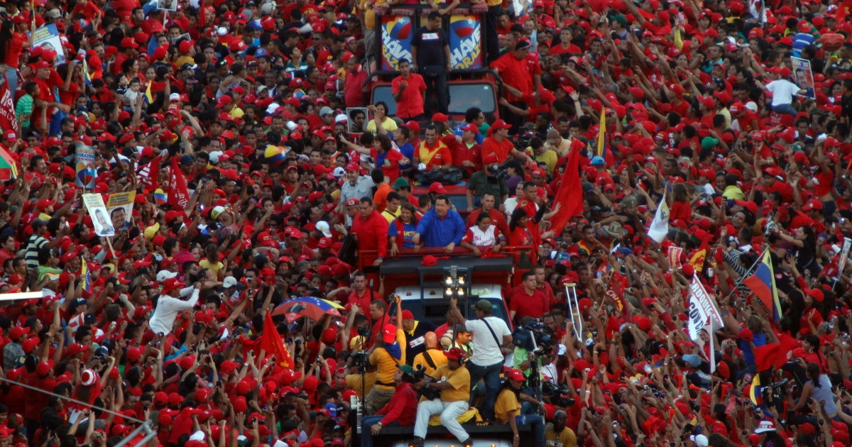 Venezuelan President Hugo Chavez waves at supporters during a campaign rally in Monagas, in northeastern Venezuela, on Sept. 28. Chavez is seeking a third six-year term, and polls place him ahead of rival Henrique Capriles in the Oct. 7 vote.</p>