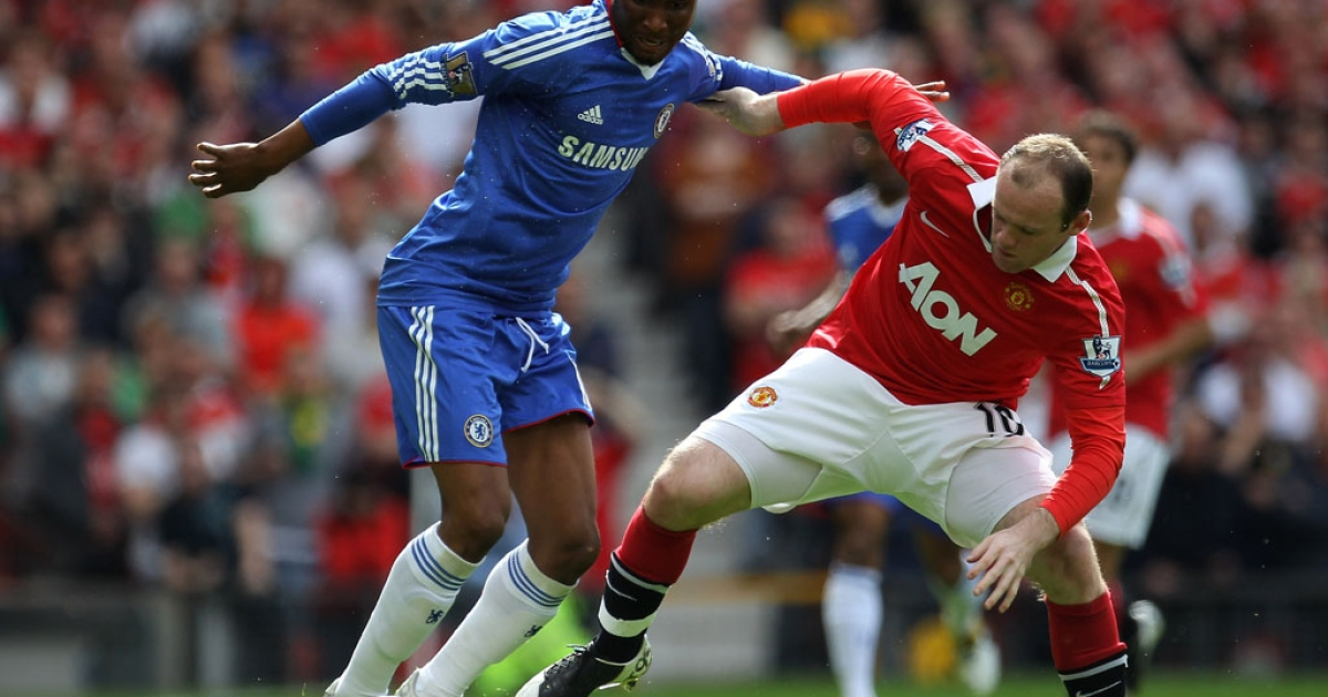John Obi Mikel (left) of Chelsea is challenged by Wayne Rooney of Manchester United during a match last season. The father of the Nigeria and Chelsea star has been kidnapped in the central Nigerian city of Jos.</p>