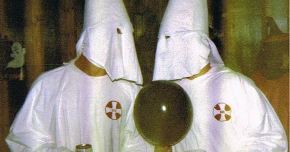 In a screengrab from the WSB Atlanta news website, Cherokee County Sheriff Roger Garrison and a friend wear KKK costumes to a Halloween party.</p>
