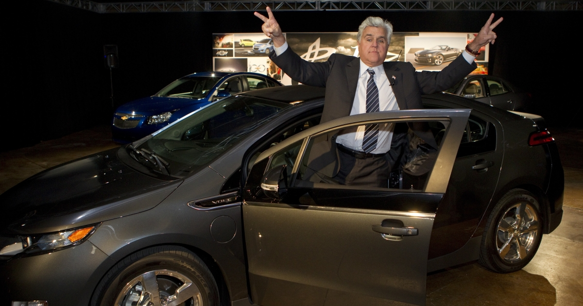 Tonight Show Host and auto enthusiast Jay Leno greets the audience after steering his personal Chevrolet Volt electric vehicle – with more than 10,000 electric miles driven – into an event at the J Lounge in Los Angeles on Nov. 15, 2011.</p>